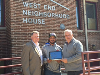 Durrell Downing (center), Precision AirConvey star employee, stands with Tom Embley, CEO, President (left) and Paul Calistro, Jr., Executive Director (right) at West End Neighborhood House. Precision AirConvey donated six laptops for career and educational purposes to honor of Downing, a graduate of the West End Neighborhood House program.